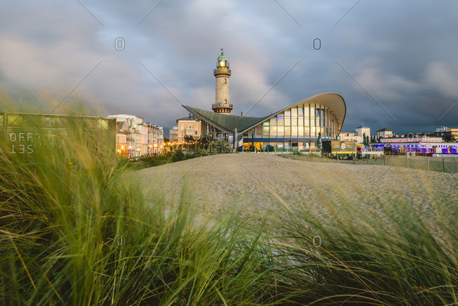 Warnemunde - July 16, 2017: Warnemunde, Rostock, Baltic coast, Mecklenburg-Western Pomerania, Germany. Lighthouse and Teepott Building.