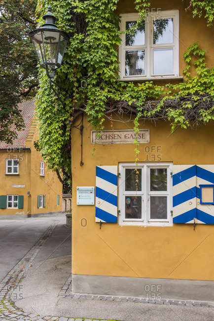 Street view of the Fuggerei settlemment, the world's oldest social housing complex still in use, Augsburg, Bavaria, Germany