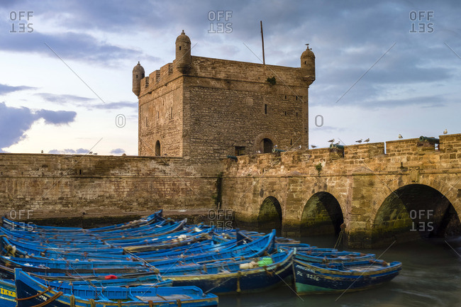 December 17, 2016: Morocco, Marrakesh-Safi (Marrakesh-Tensift-El Haouz) region, Essaouira. Skala du Port, 18th-century seafront ramparts on the fishing port at dusk.