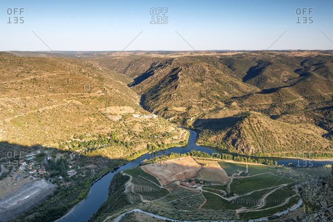 Douro river between Portugal and Spain, in the evening. Portugal on the foreground and Spain on the background. Portugal