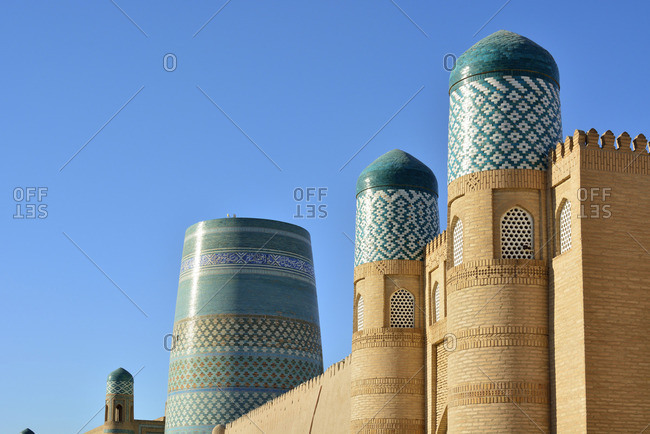 The main gate to the Khuna Ark citadel and the Kalta Minor minaret. Old town of Khiva (Itchan Kala), a Unesco World Heritage Site. Uzbekistan
