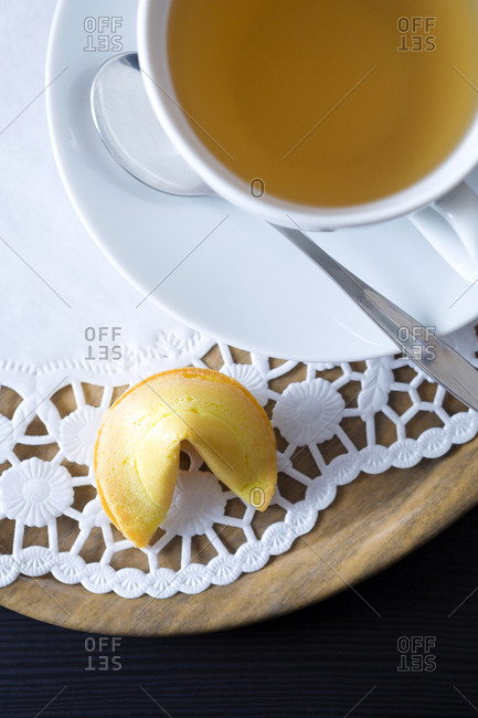 Fortune cookie and cup of tea on tray