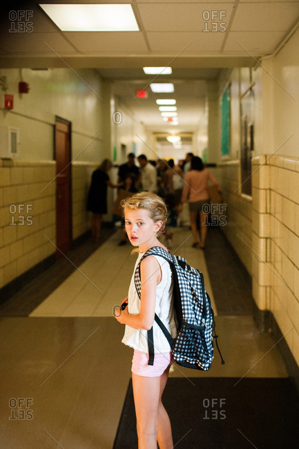 Little girl in school hallway