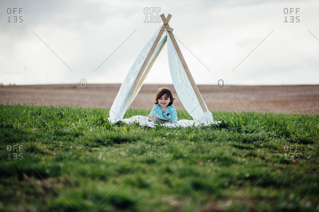 Girl in tent structure