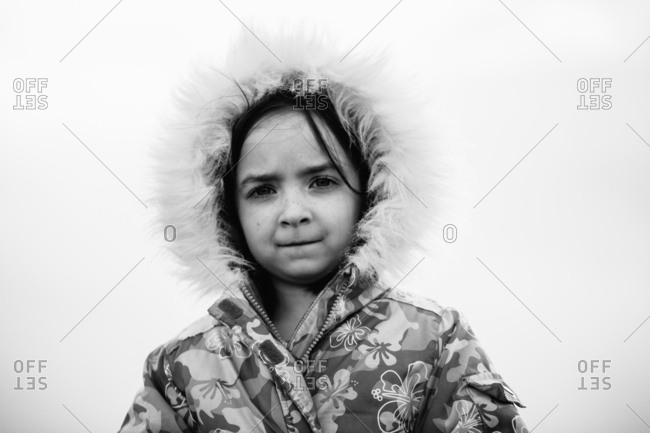 Portrait of a brunette girl in coat looking at camera