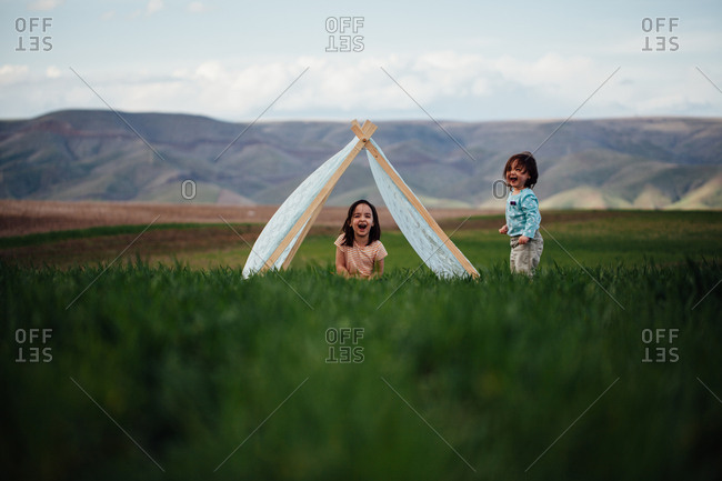 Girls laughing in teepee