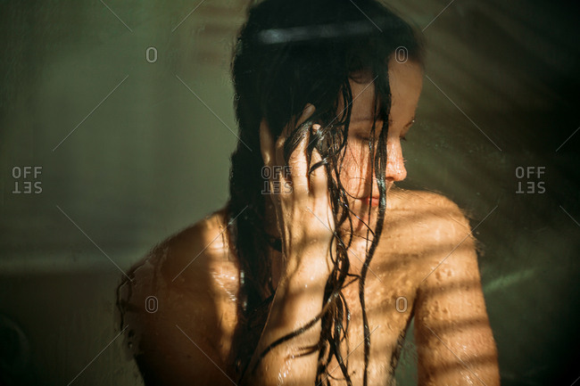 Portrait of a woman with wet hair in shower