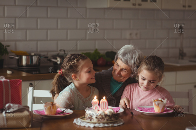 Grandmother celebrating her birthday with granddaughters at home