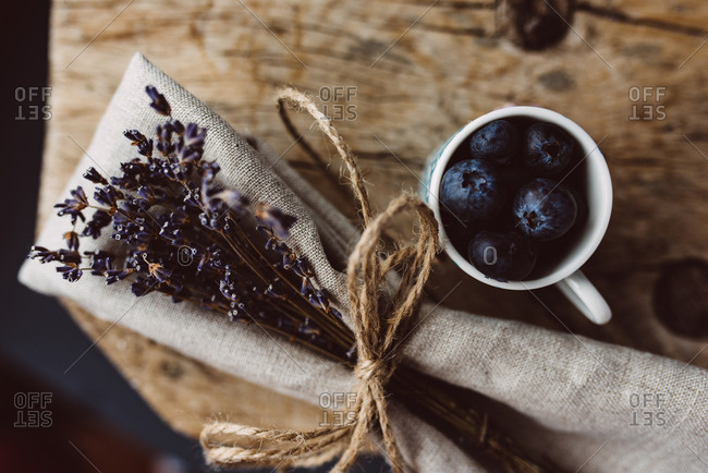 Above shot of blueberries in a cup next to the dry lavender