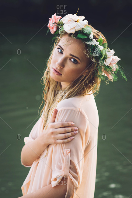 Portrait of blonde girl with flower hair band