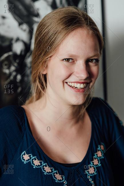 Portrait of adolescent blonde girl smiling