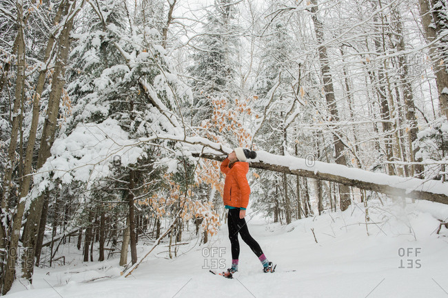 Girl walking on snowshoe trail in the Adirondack Mountains