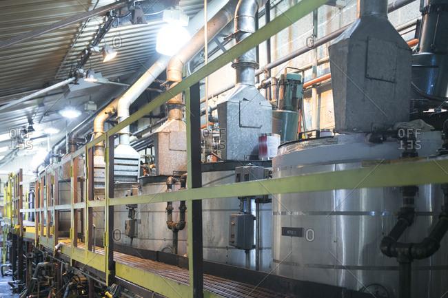 East Hanover, New Jersey - November 29, 2017: Industrial equipment along factory platform wall