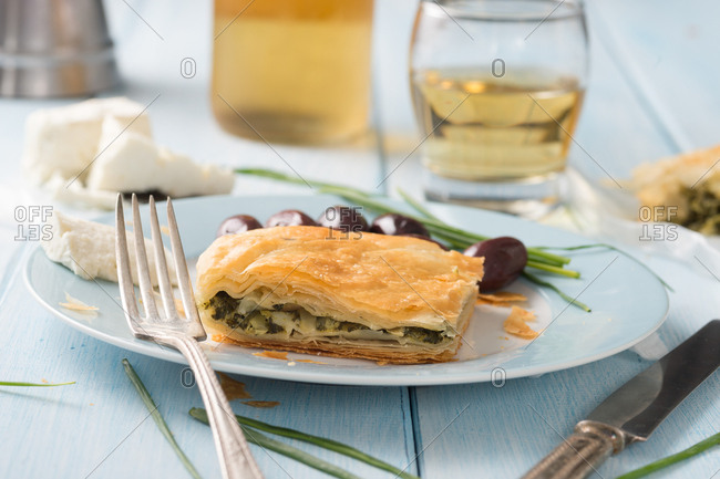 Greek spinach pie spanakopita with feta goat cheese and marinated black olives with retsina wine