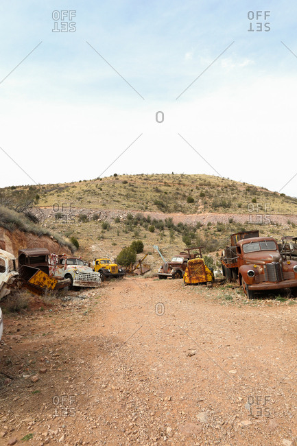 Arizona, USA - March 20, 2014: Old rusty cars and trucks in a scrap yard