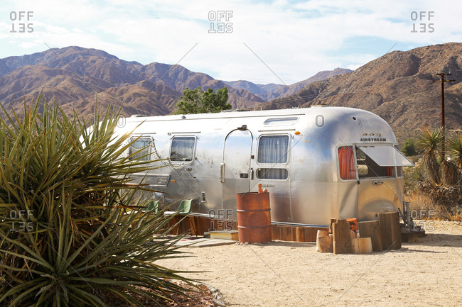 Morongo Valley, California - August 1, 2015: A vintage metal trailer in the desert sun