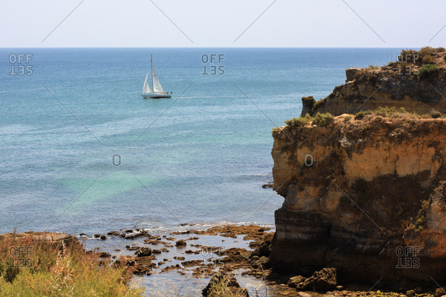 A rocky beach in the seaside town of Lagos, Portugal