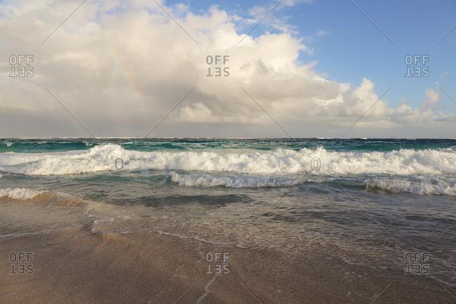 Waves crash onto a sandy beach
