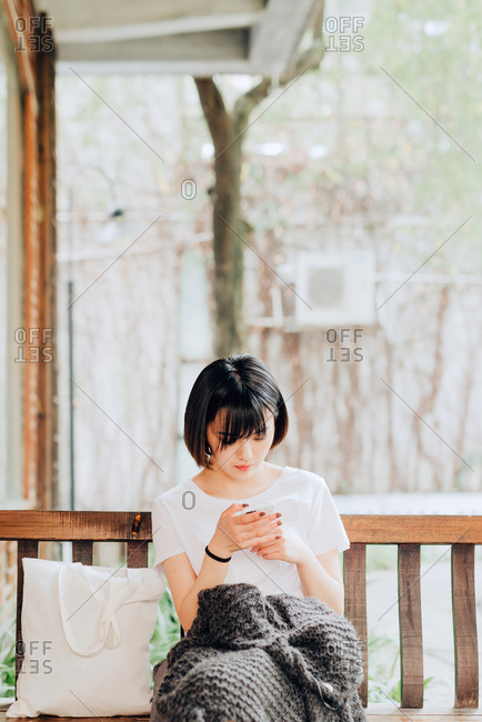 Asian young woman using cell phone