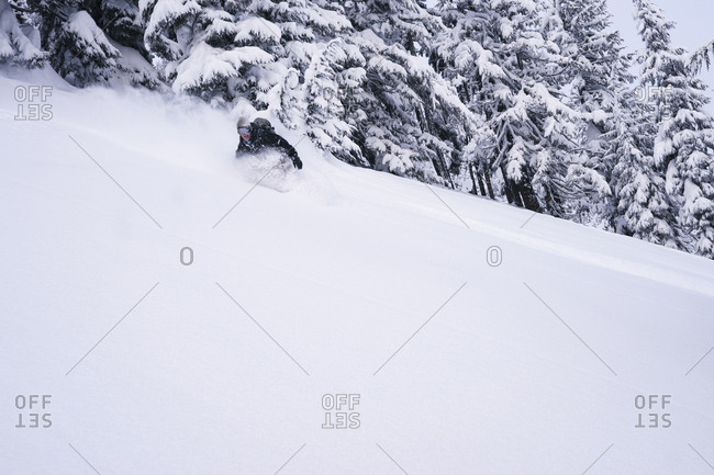 Man snowboarding on mountain during winter