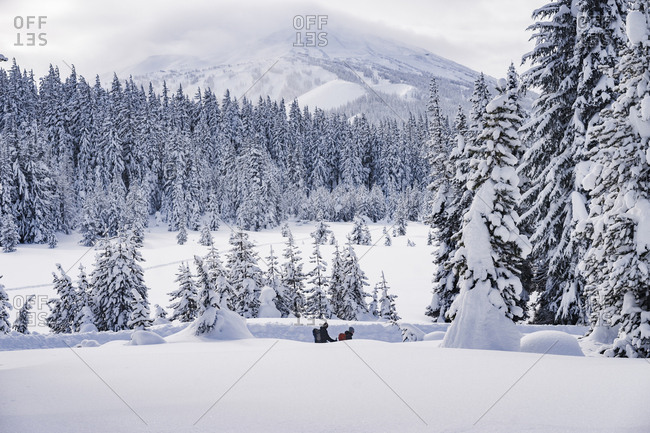 High angle view of male friends hiking on snowcapped mountain