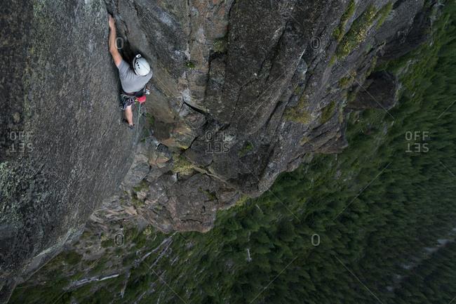 High angle view of hiker rock climbing