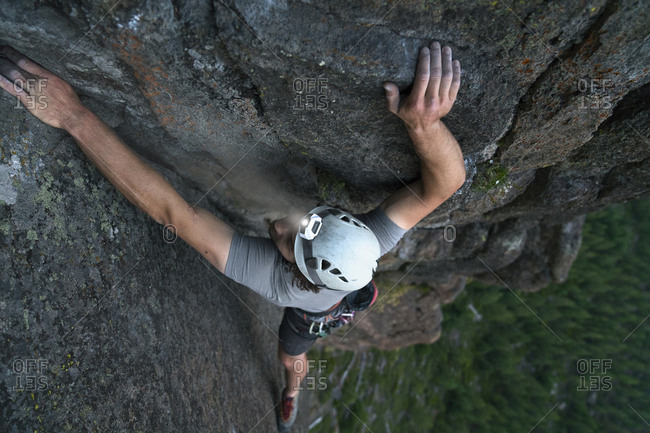 High angle view of male hiker rock climbing