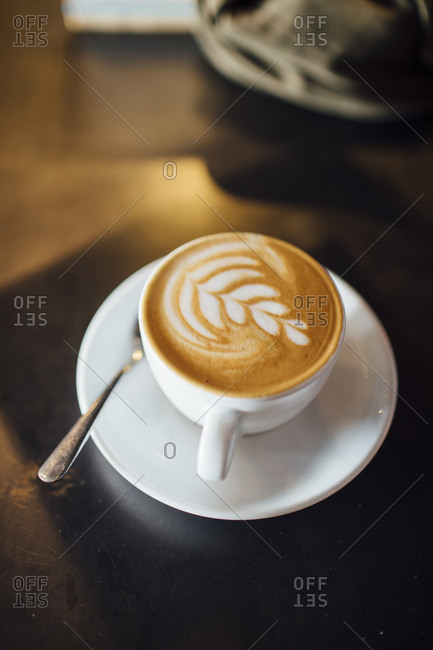 High angle view of latte on table in cafe