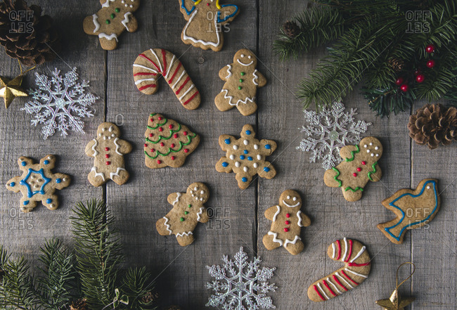 Overhead view of decorated gingerbread cookies on wooden table