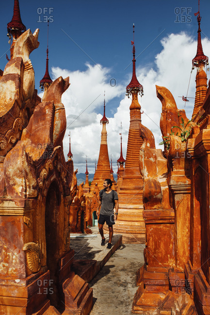 Man walking by stupas at Shwe Indein Pagoda