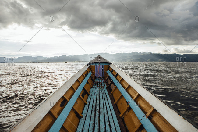 Boat on Inle lake against mountains