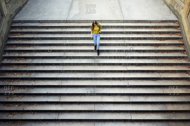 High angle view of woman moving down steps at park