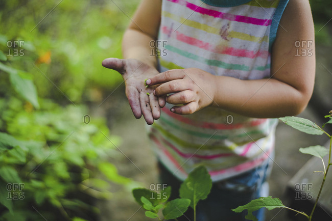 High angle midsection of girl standing by plants