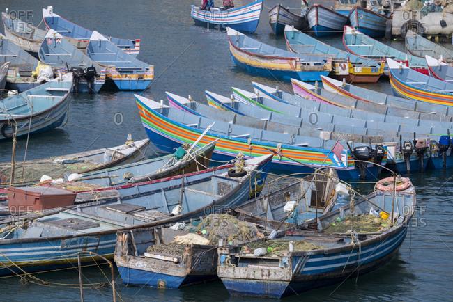 Kerala, India - February 10, 2017: Malabar coast port city of Villanjam (Vizhinjam) along the coast of the Arabian Sea, Traditional wooden fishing boats in the harbor
