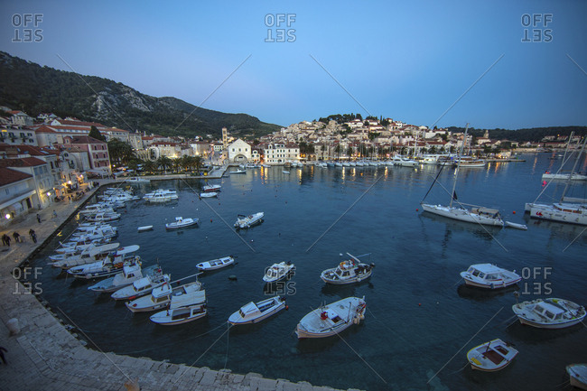 Hvar Island, Croatia - May 7, 2016: Boats in harbor at sunset