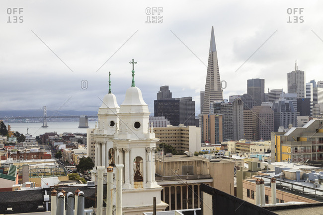San Diego, California, USA - February 11, 2012: Our Lady of Guadalupe Church with views towards the Bay Bridge and the financial district with the Transamerica Building