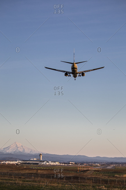Portland, Oregon, USA - February 15, 2015: Commercial aircraft on final approach at PDX airport with Mount Hood in the background