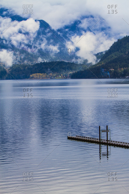 Harrison Hot Springs, British Columbia, Canada, Dock ends looking at a glacier fed lake, mountains and rising fog