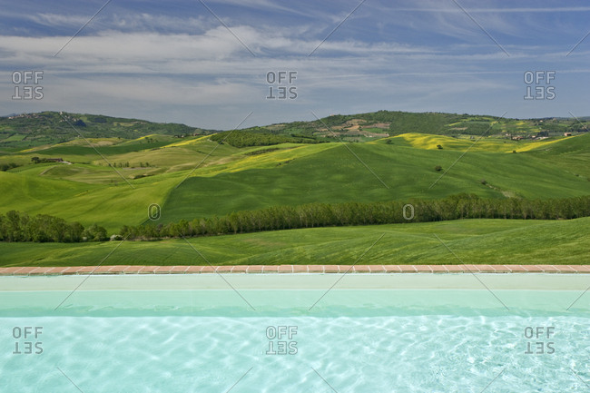 Italy, Tuscany, Landscape seen from villa's backyard swimming pool