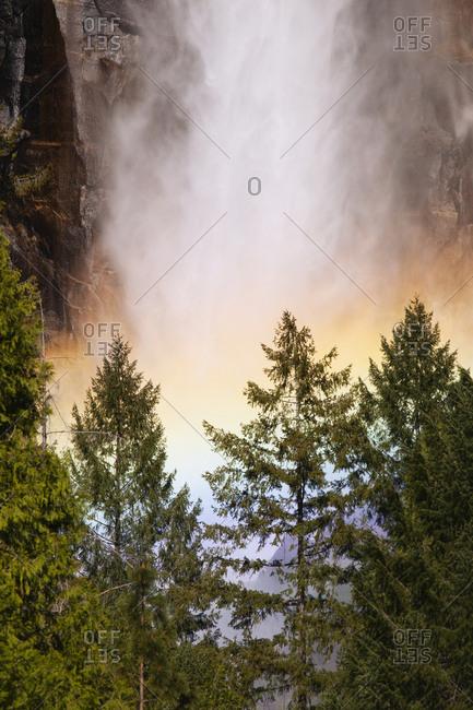 USA, California, Yosemite National Park, Rainbow at base of Yosemite Falls