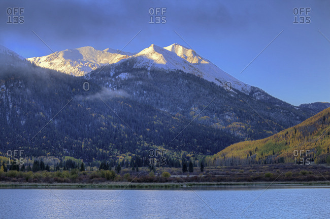 USA, Colorado, San Juan Mountains, Sunrise on mountain and Crystal Lake