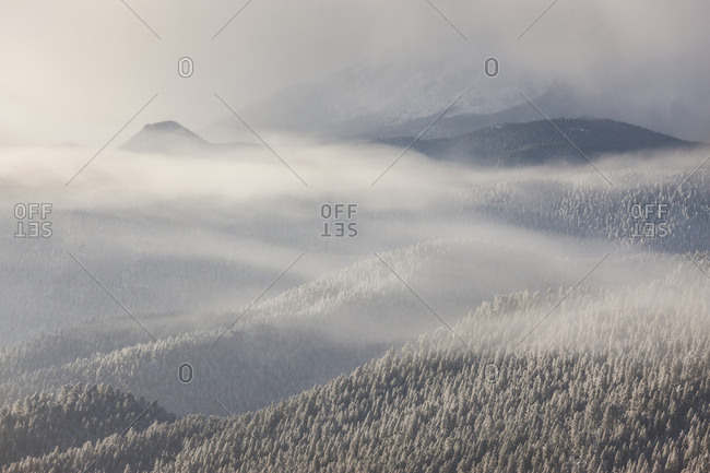USA, Colorado, Pike National ForeSt. Clouds and snow-covered forests