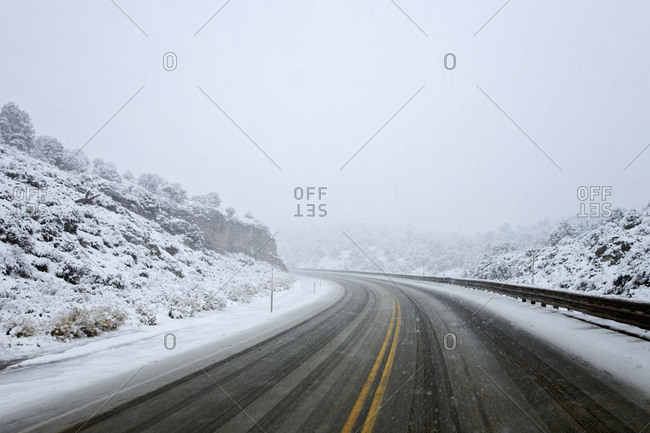USA, Nevada, Snowy day on Highway 50 near Ely