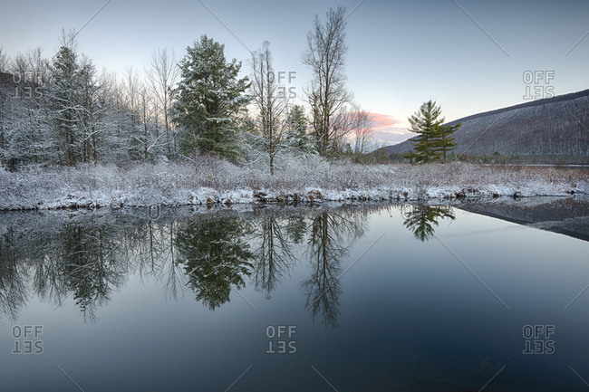 USA, New York State, Winter morning reflections on Labrador Pond