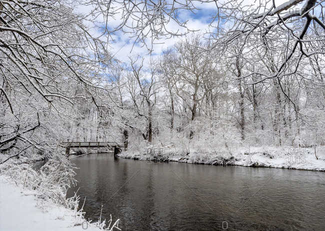 USA, Pennsylvania, Philadelphia, Snow-covered trees and river bridge