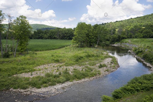 Ottauquechee River flowing through green countryside in historic Woodstock, Vermont