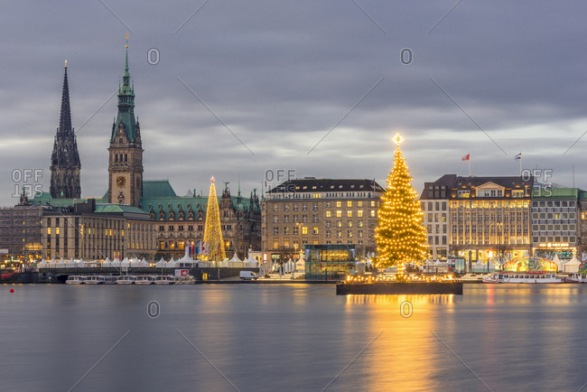December 4, 2017: Germany- Hamburg- Jungfernstieg- town hall- St. Nicholas' Church- Christmas tree- Binnenalster in the evening