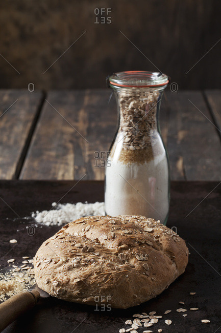Spelt bread and glass bottle of ingredients for spelt bread