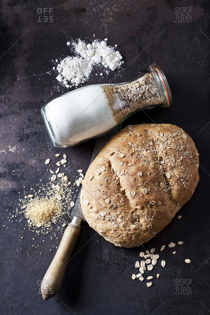 Two spelt breads and ingredients for preparing spelt bread