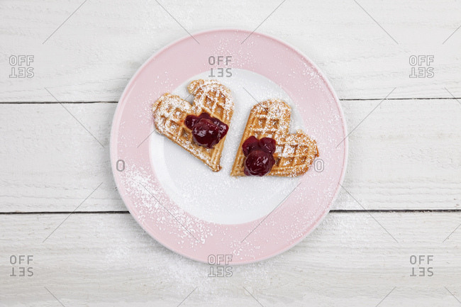 Homemade waffles with cherries- waffle hearts for two on plate